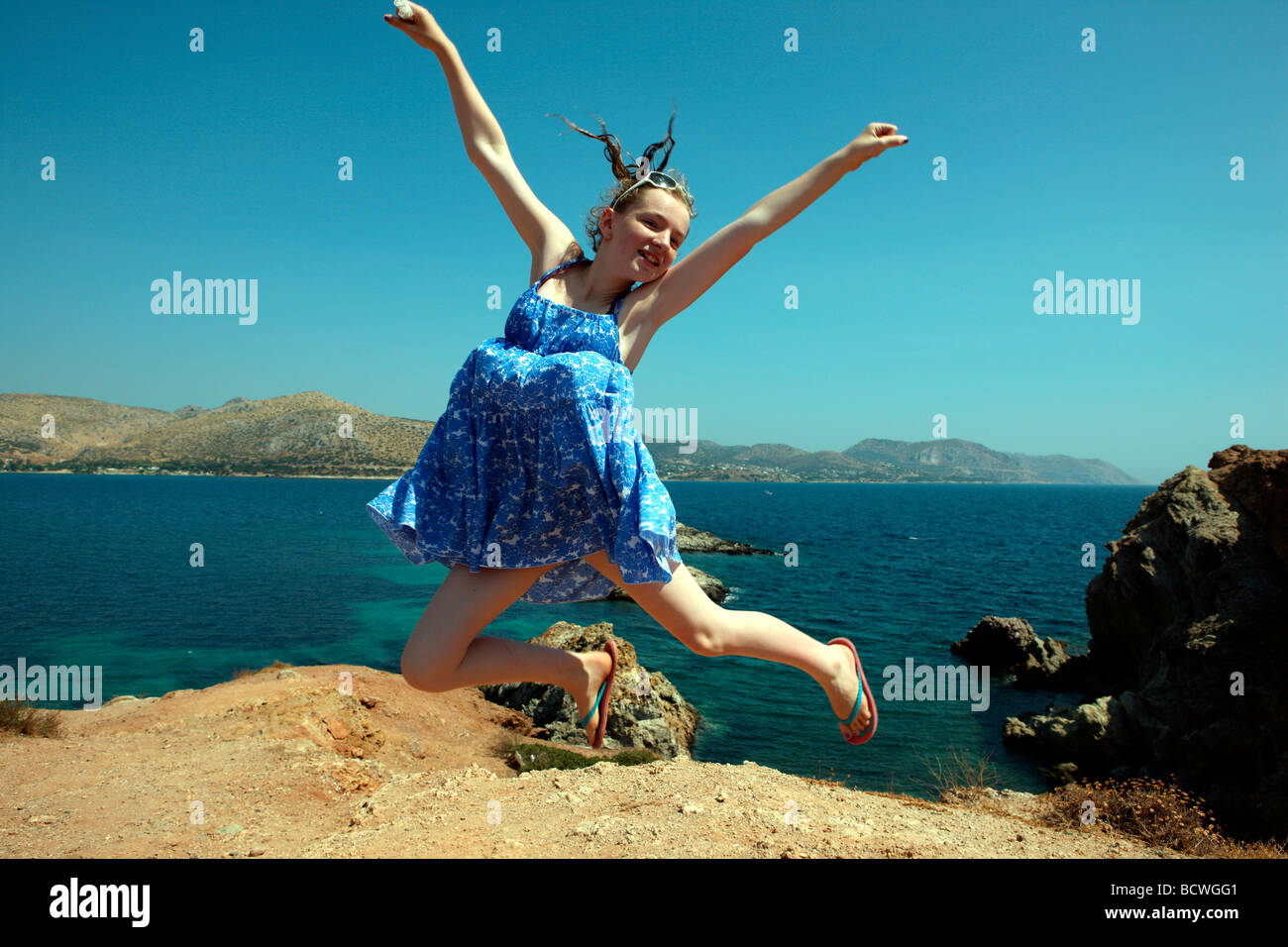 pretty-young-girl-leaping-in-the-air-at-