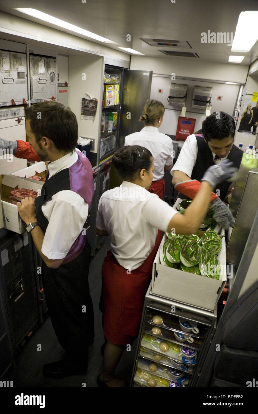Members Of Cabin Crew Prepare To Serve Meals In The Galley
