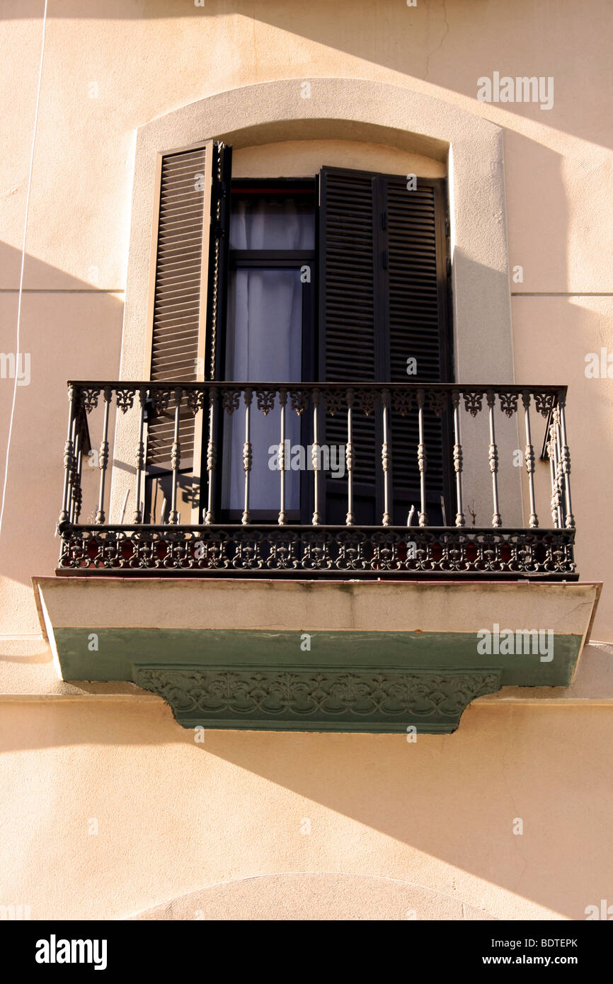 Spanish Window With Wrought Iron Balcony And Wooden Shutters Stock Photo Royalty Free Image