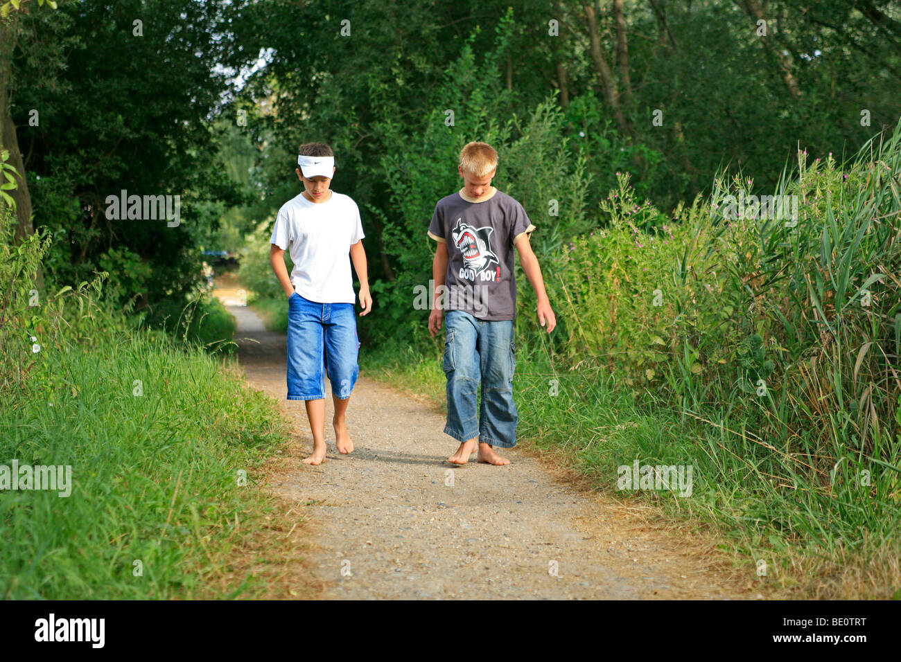 http://c7.alamy.com/comp/BE0TRT/young-boys-walking-barefoot-along-a-forest-path-BE0TRT.jpg