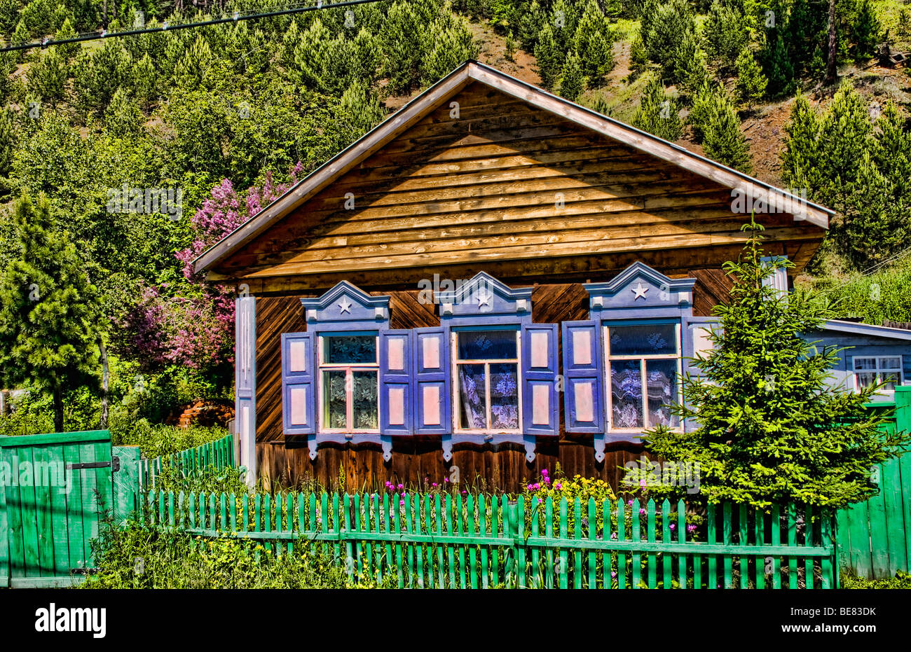 Beautiful old wooden houses with shutters in famous style for Beautiful classic houses