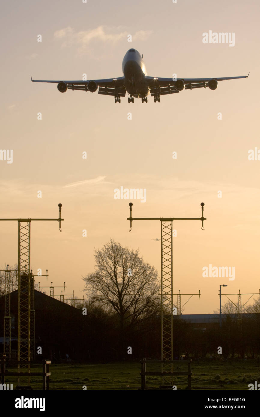 Large commercial airliner approaching London Heathrow Airport, England, UK. Stock Photo