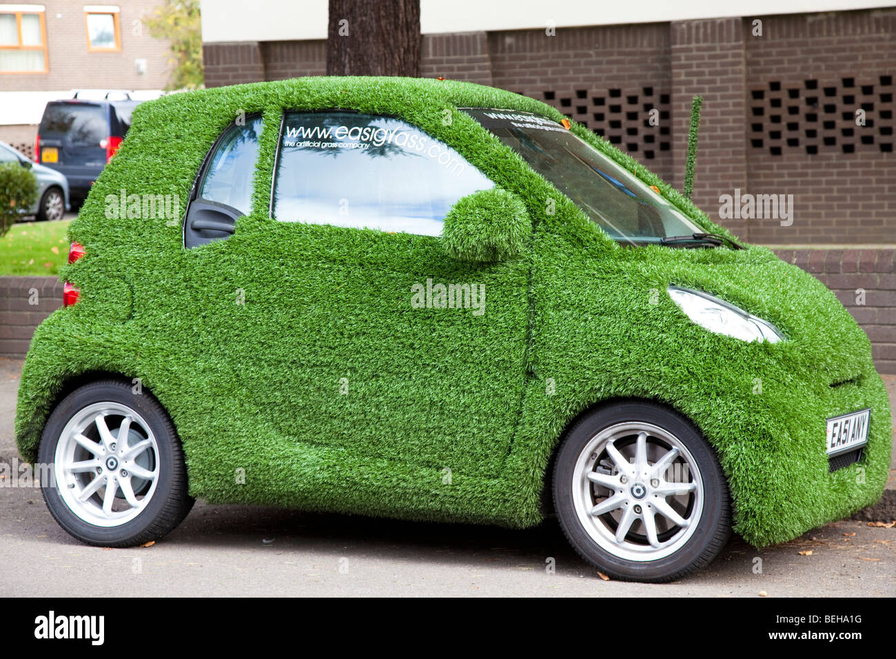 smart car covered in artificial grass in street london uk stock photo  royalty free image