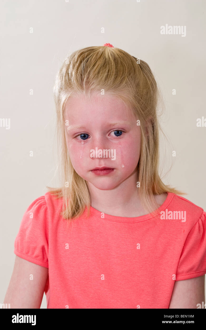 6 year old girl crying with deep sadness.grief facial ...
