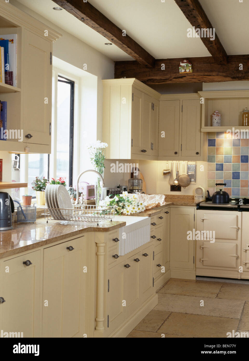 Belfast Sink Below Window In Country Cottage Kitchen With Cream Stock Photo Royalty Free Image