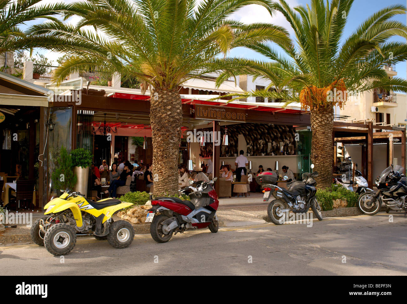 Crowded Living Room Caf Bar With Motorbikes And Palm Trees Stock Photo Royalty Free Image