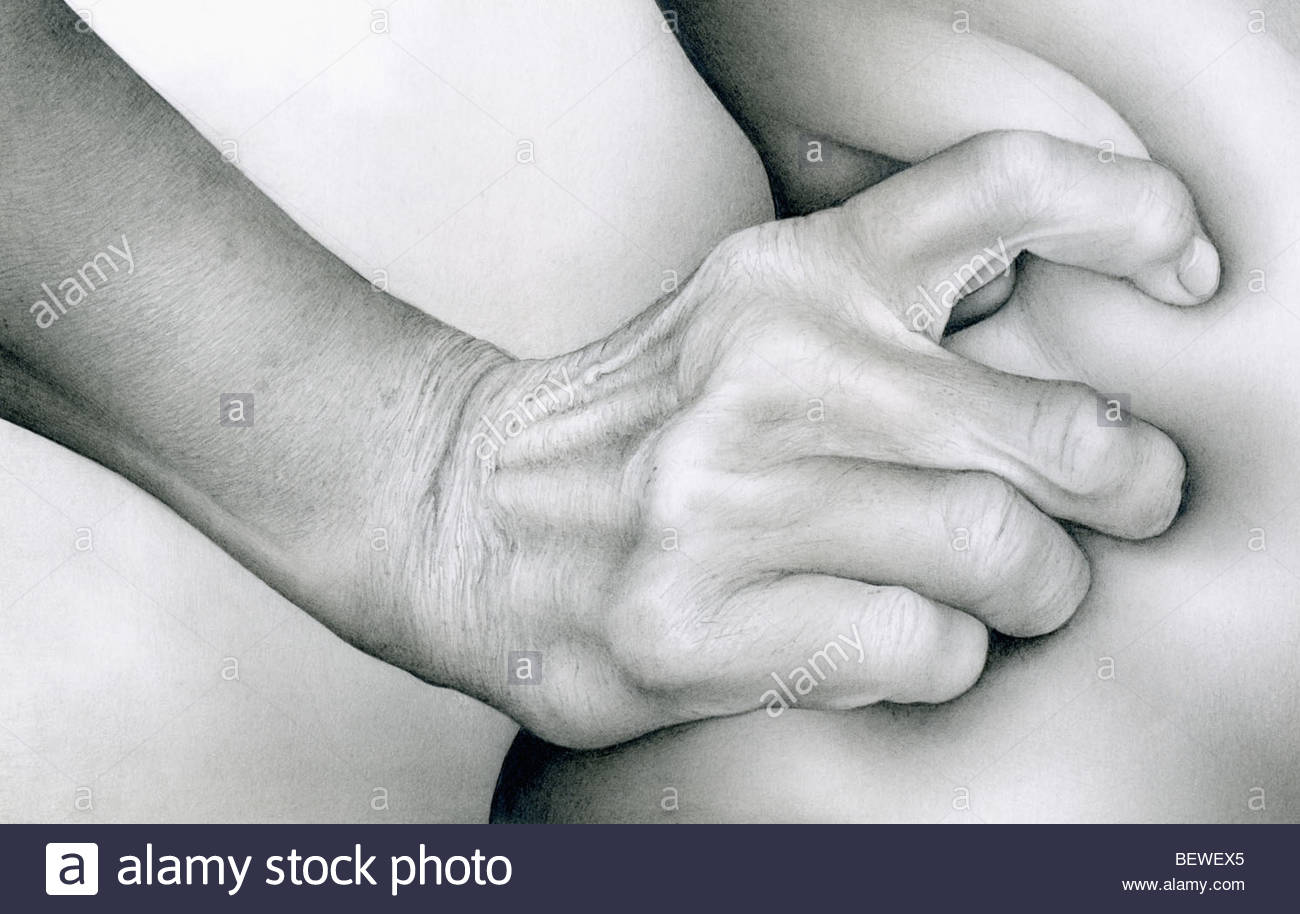 Close up of hand squeezing skin Stock Foto
