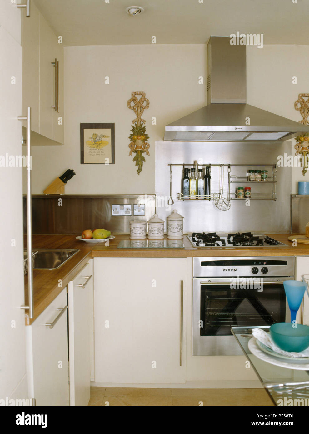 Small Modern Cream Kitchen With Stainless Steel Extractor