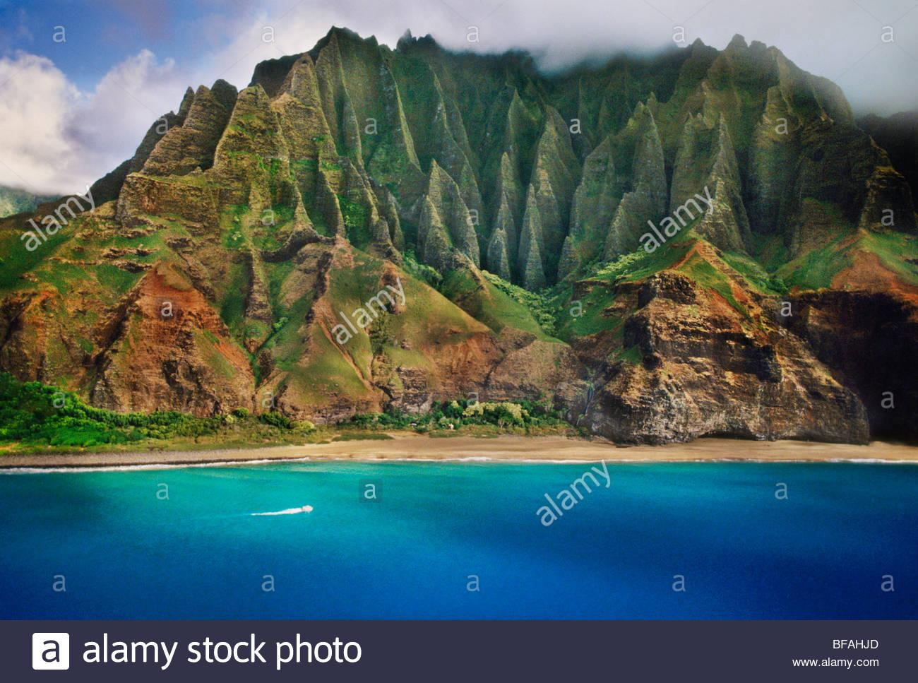 Tourist boat along Na Pali coast (aerial), Kauai, Hawaii