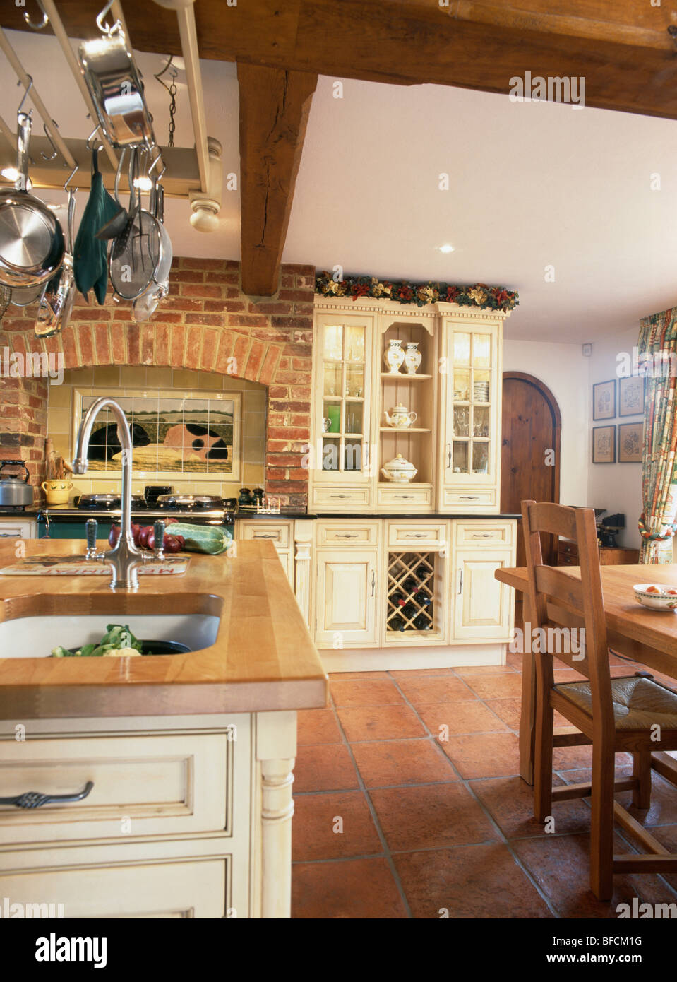 Terracotta floor tiles and exposed brick wall in country for Terracotta kitchen ideas