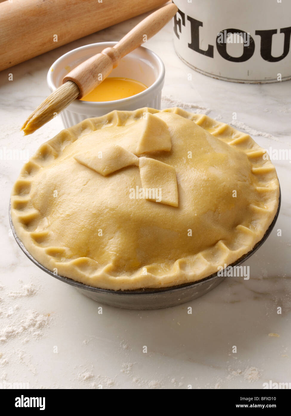 Shortcrust Pastry Pie In A Pie Tin Egg Yolk Brushedh Stock