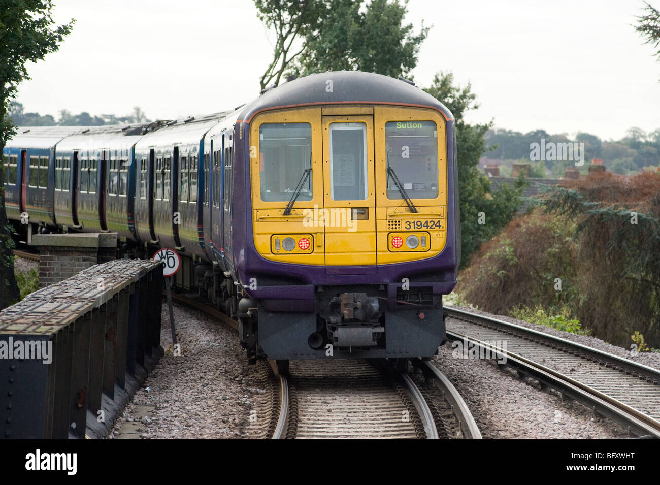 Electric Power Rail : Class electric multiple unit train running on third