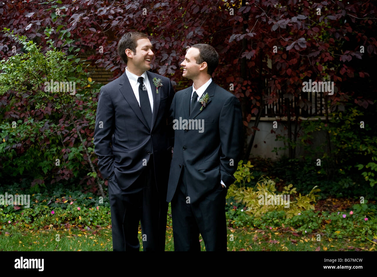 Wedding Gift Ideas For Older Gay Couple : Two gay men kissing and smiling after their wedding Stock Photo ...