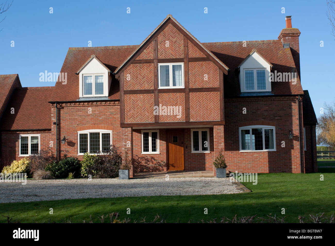 Large detached red brick country house with overhanging for Country house online
