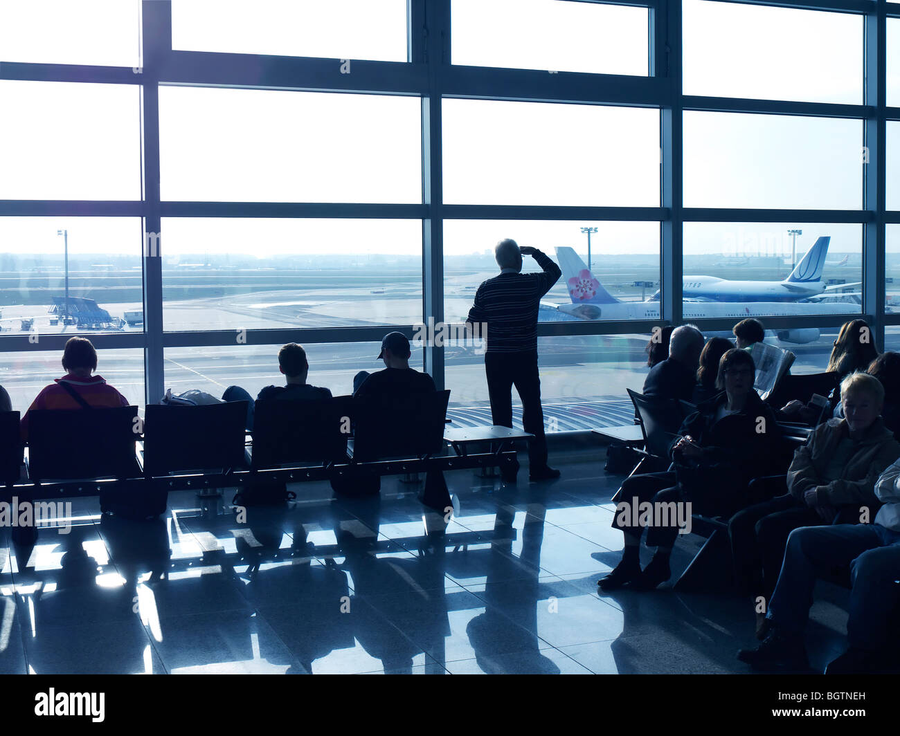 passengers in the waiting area of frankfurt am main airport germany stock photo royalty free. Black Bedroom Furniture Sets. Home Design Ideas
