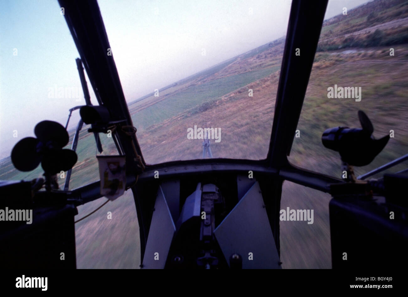Soviet Afghanistan war - Page 6 View-from-the-cockpit-of-a-russian-mi-8-helicopter-as-it-flies-into-BGY4J0