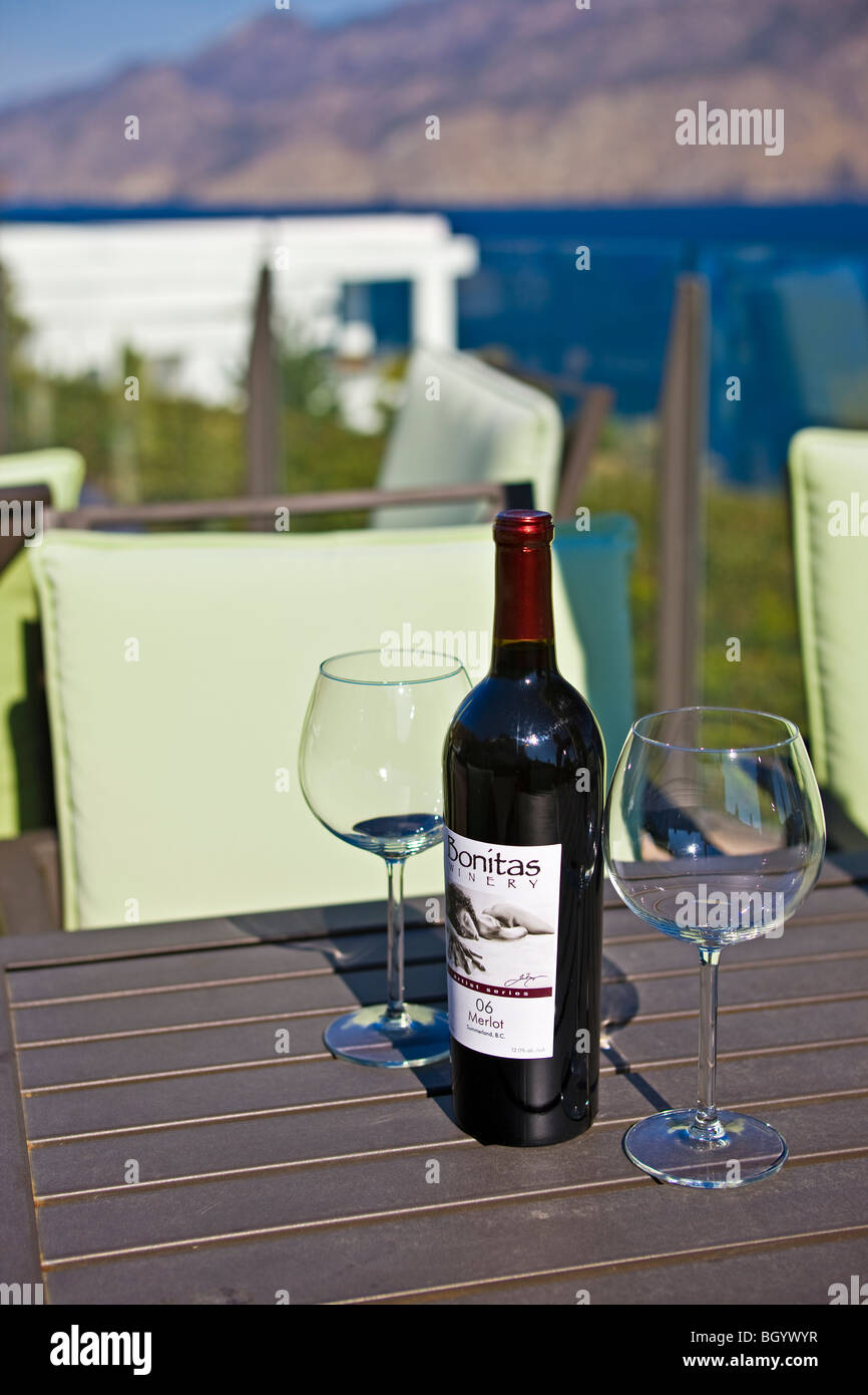Bottle of wine on a terrace table at bonitas winery for 7 summerland terrace