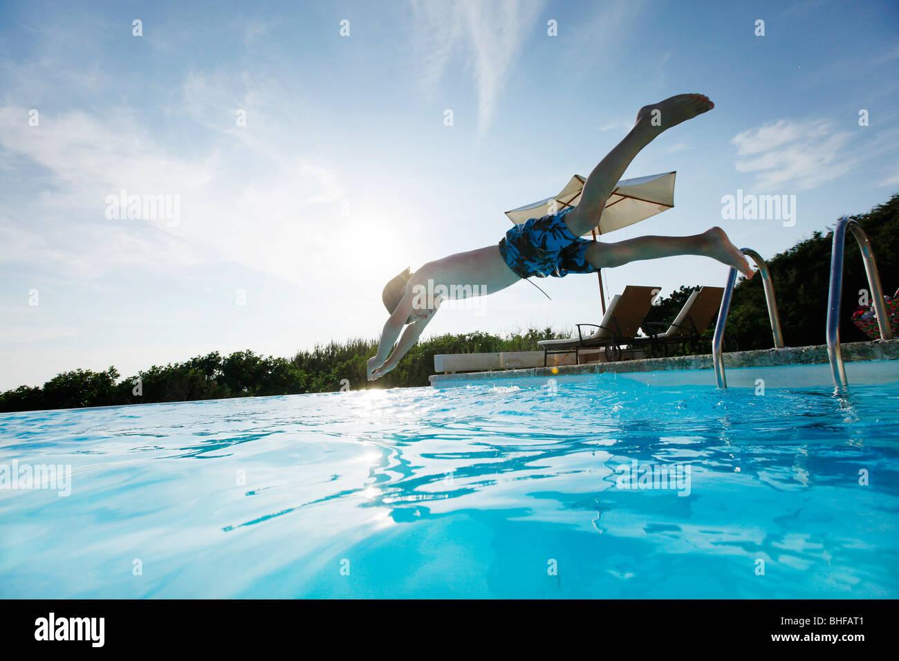 Boy diving into the pool, pool, Las Dunas Playa, Formentera, Balearic Islands, Spain Stock Foto