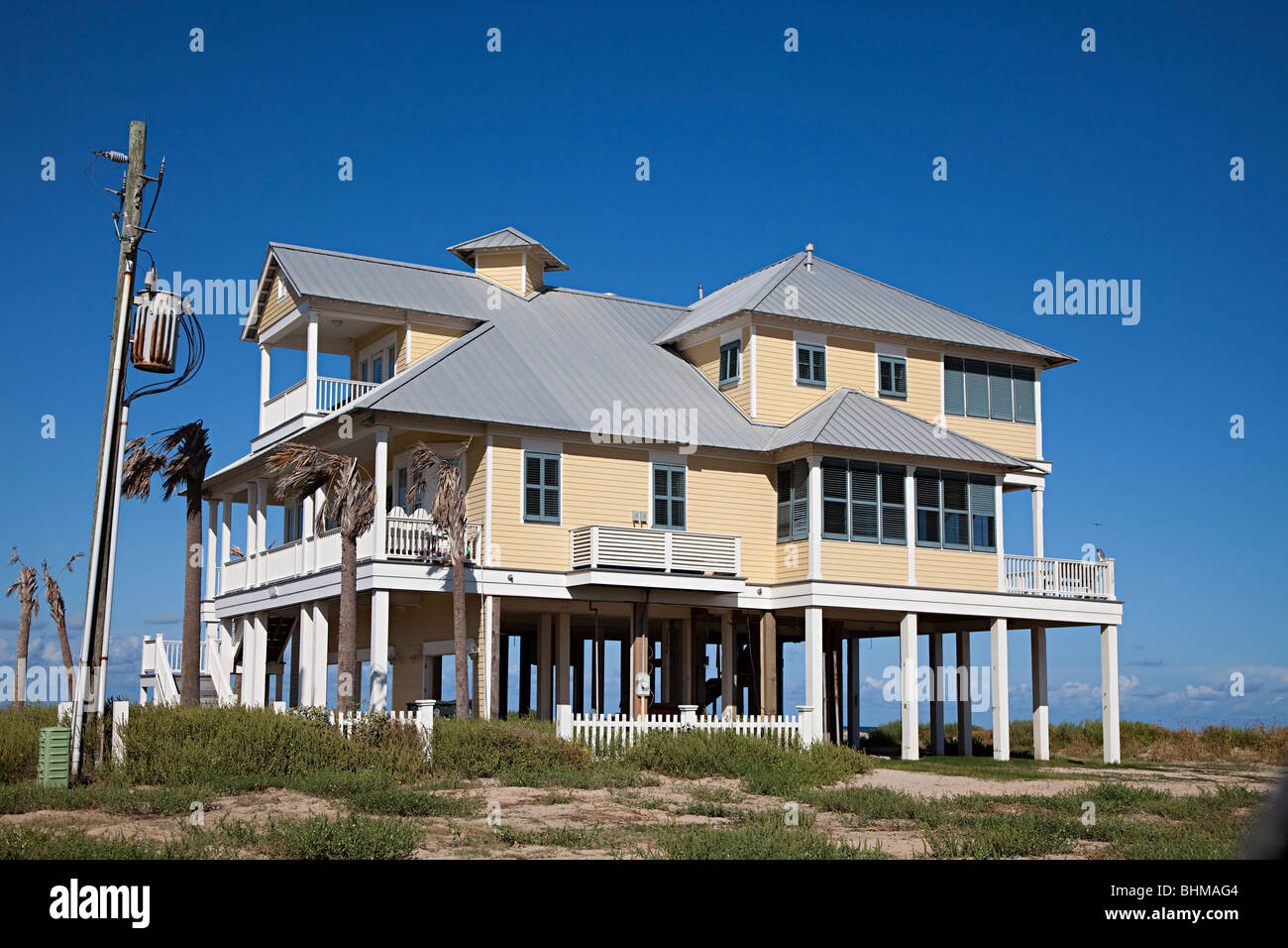 Wooden house on stilts on beach front galveston texas usa for Beach house plans on pylons