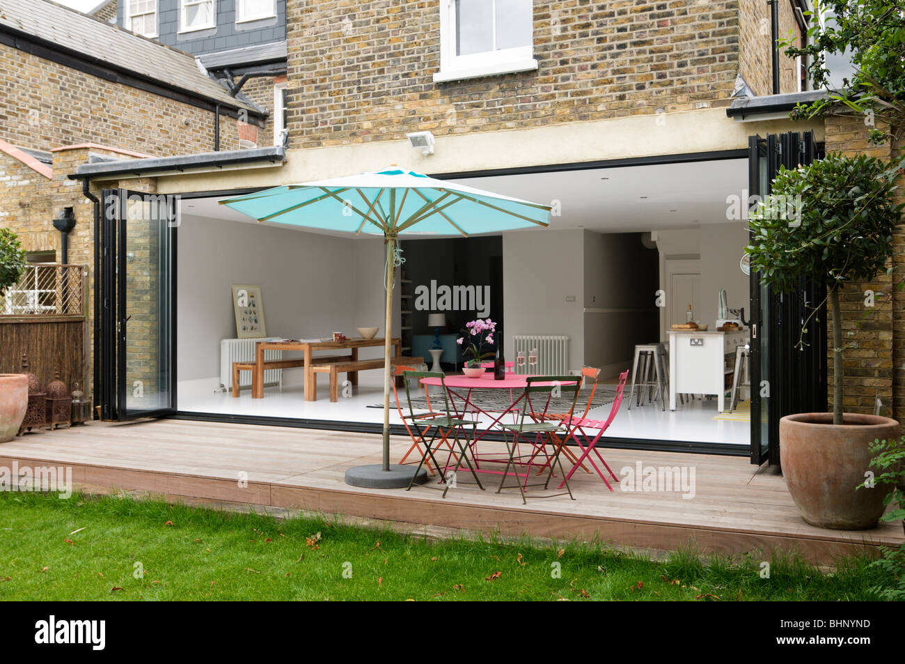 Decked patio with parasol of london victorian townhouse for Garden decking north london