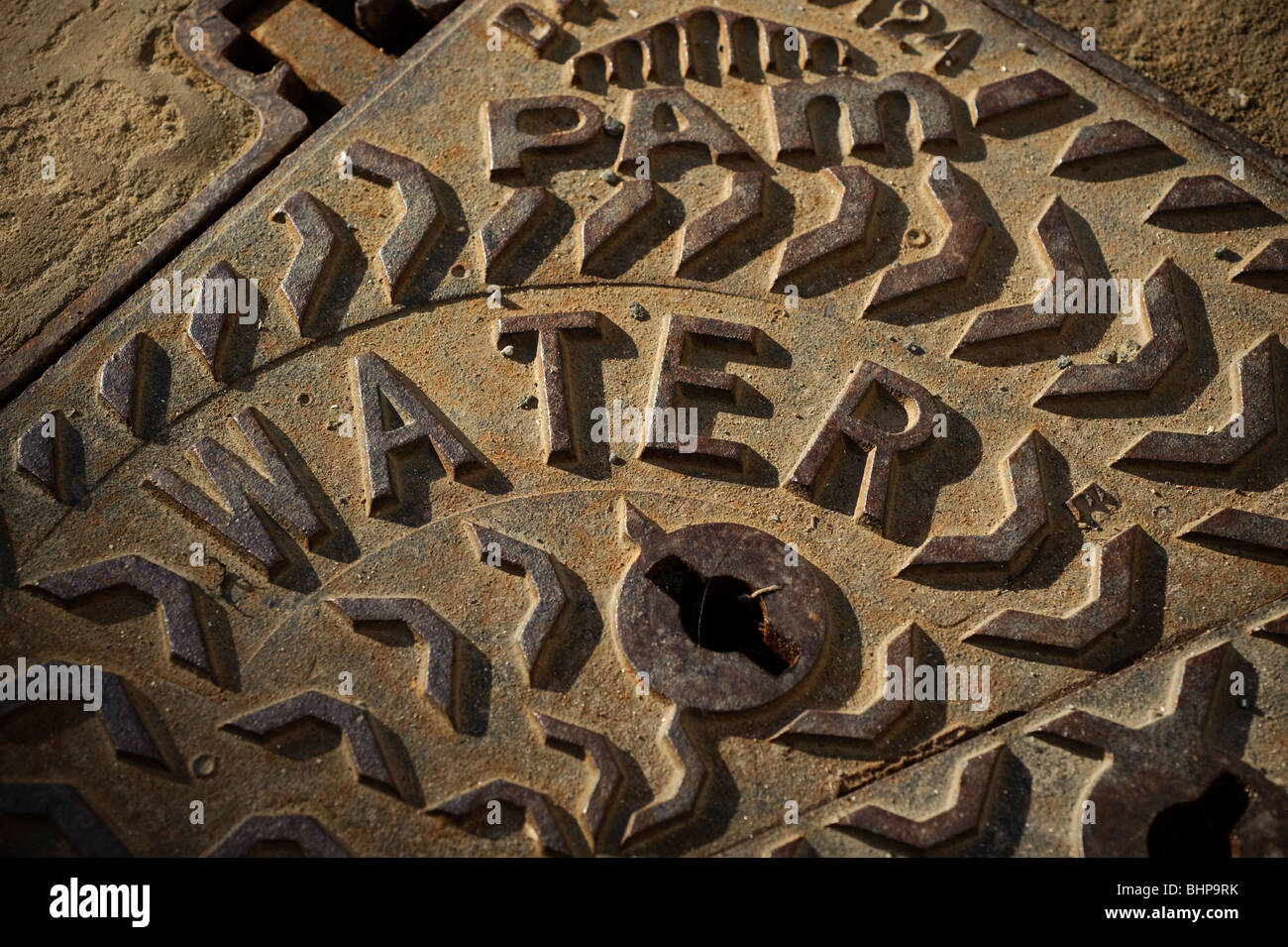 Water main cast iron manhole cover uk stock photo