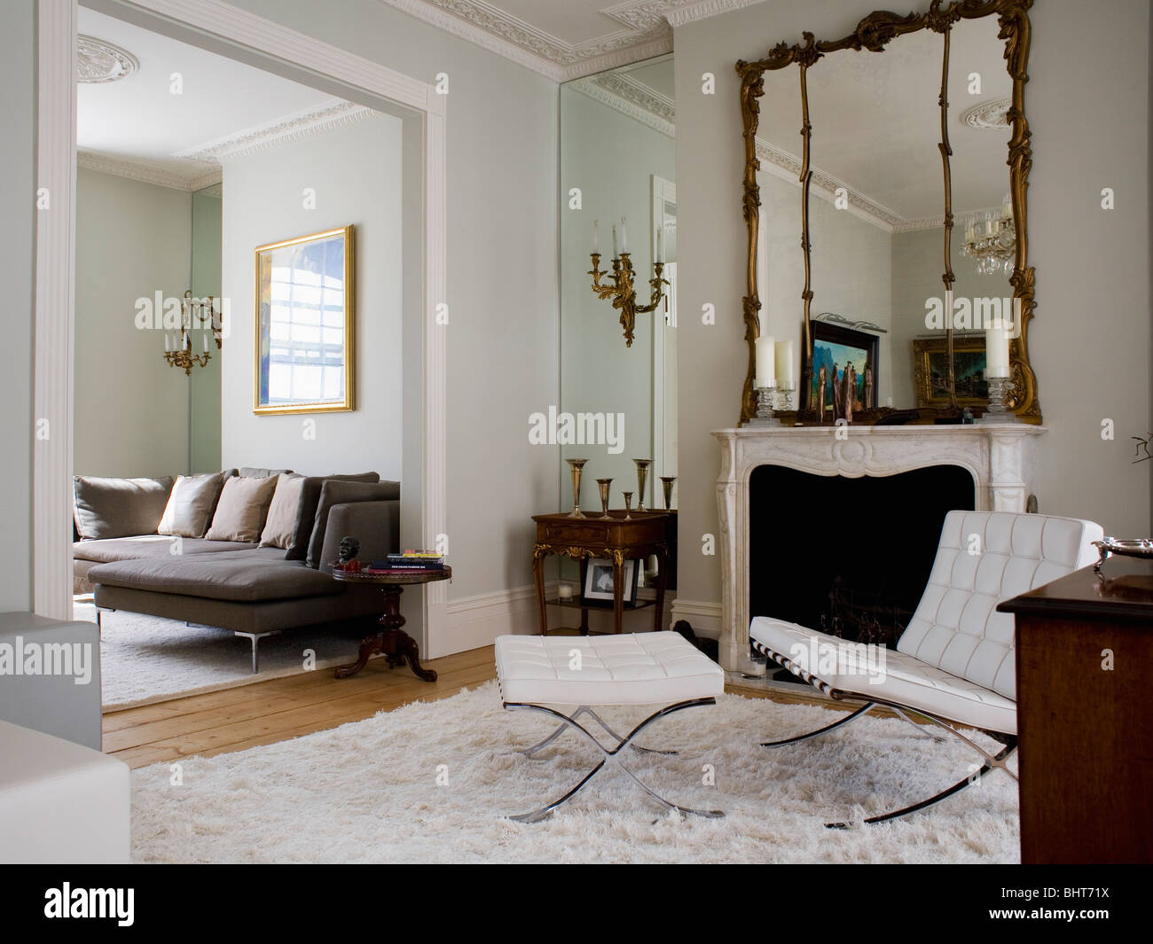 White Leather Mies Van Der Rohe Chair And Stool In Living Room With Stock Pho