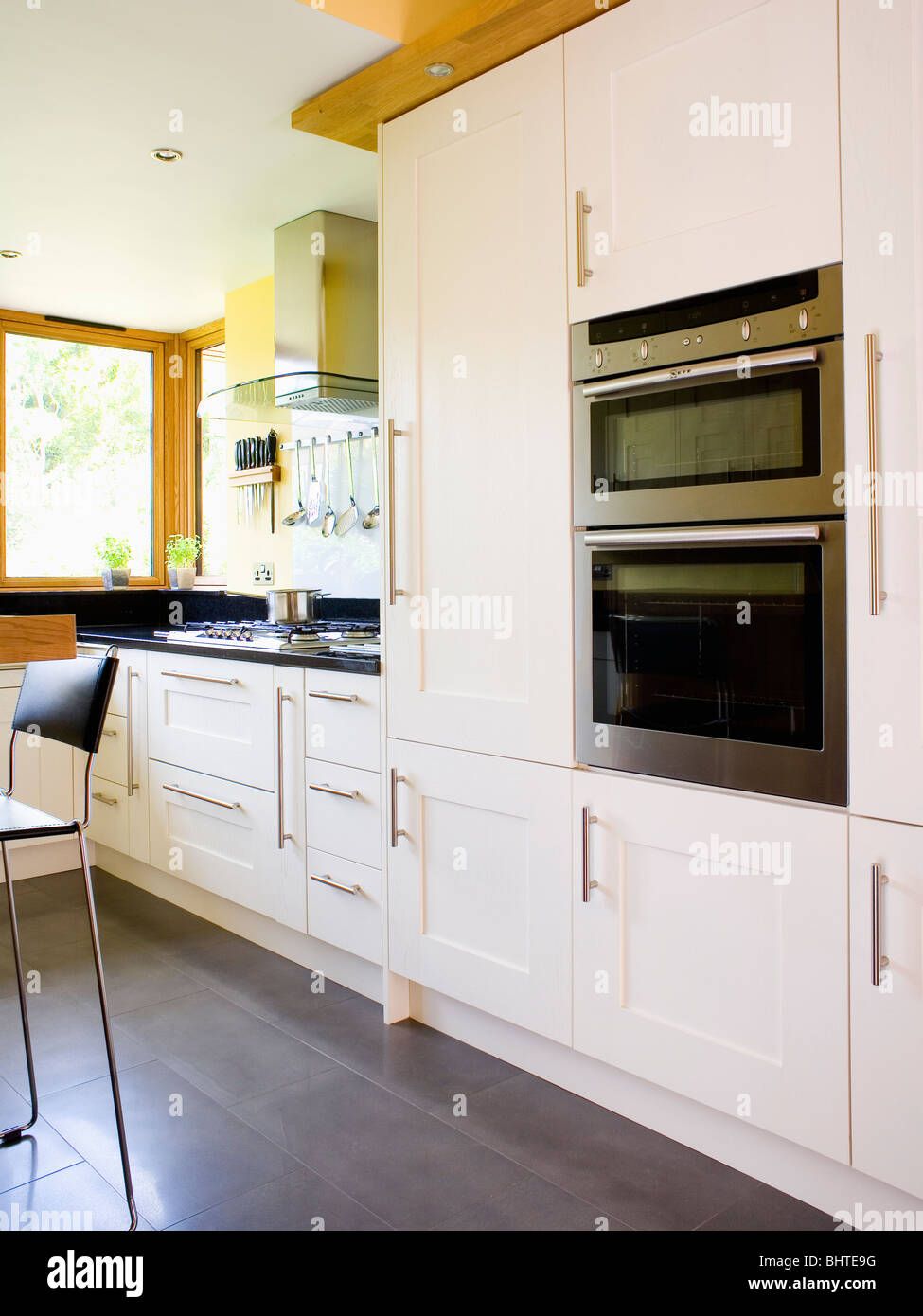 eye level double oven in white fitted unit in modern town. Black Bedroom Furniture Sets. Home Design Ideas