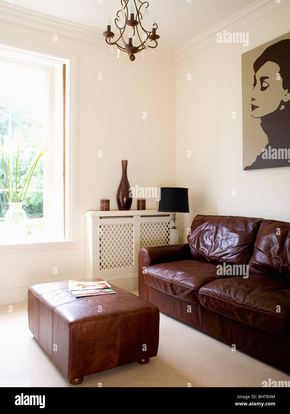Brown leather sofa and ottoman in modern cream living room - Living room with cream leather sofa ...