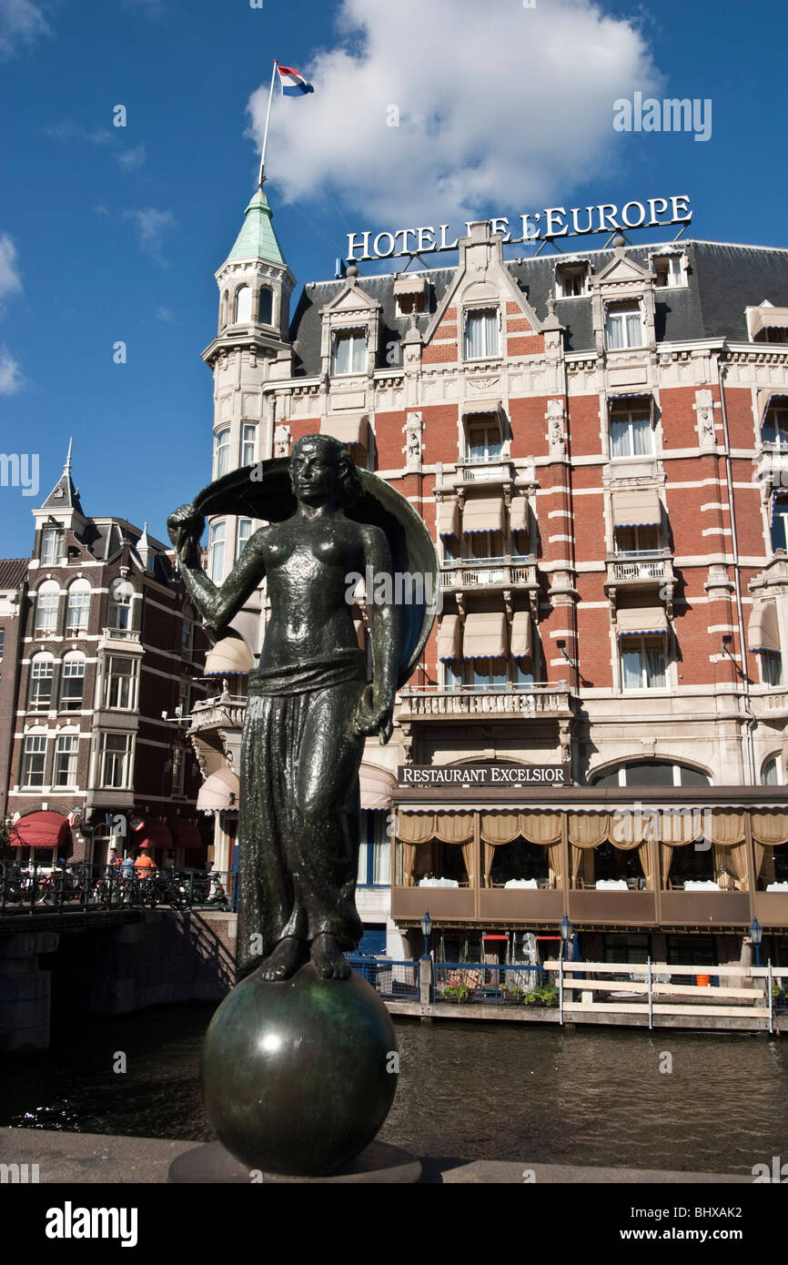 Hotel Europe, canal , sculpture, canal boat , Restaurant Exelsior , Terasse, Amsterdam, Netherlands Stock Photo