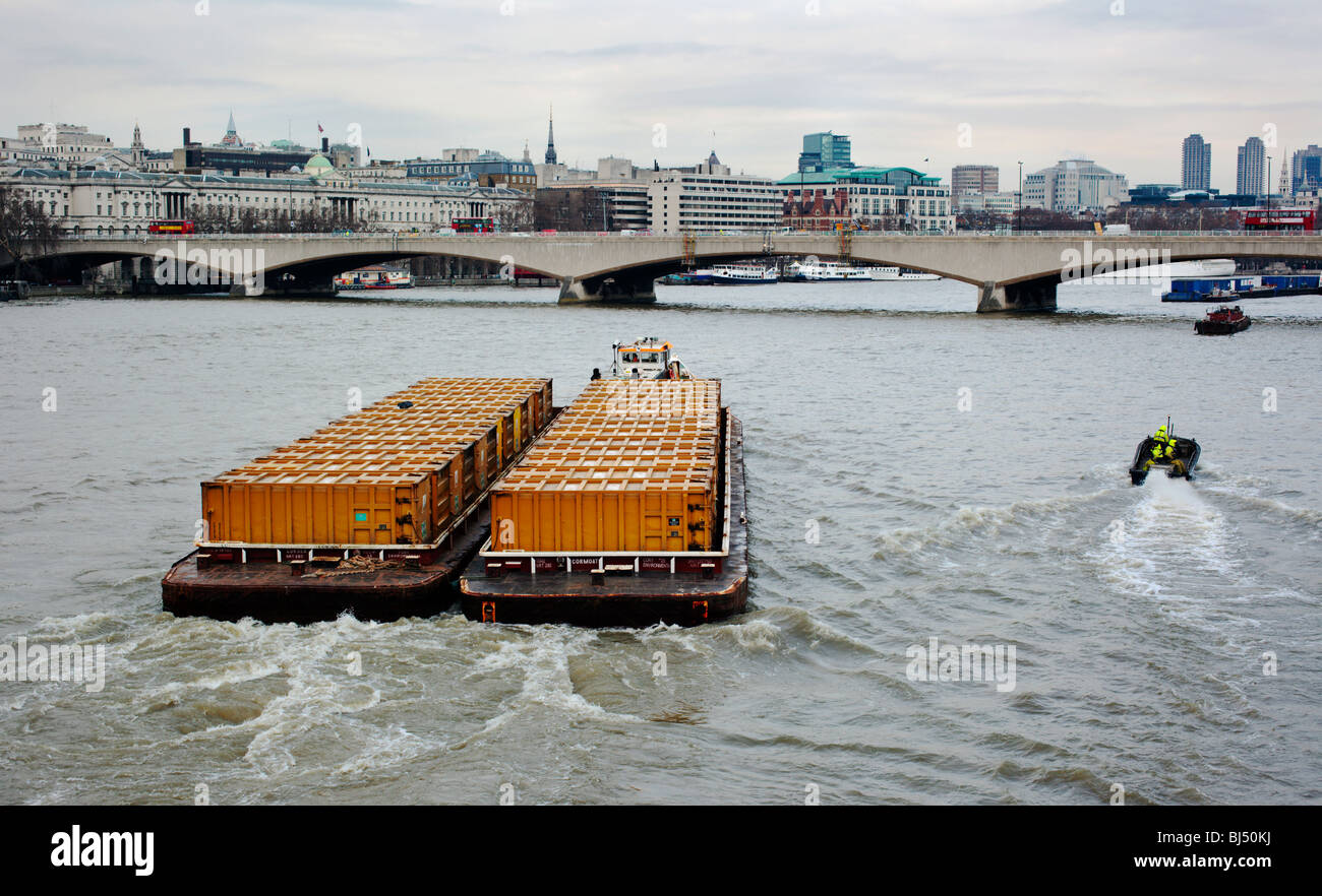 London's garbage being transported down the River Thames