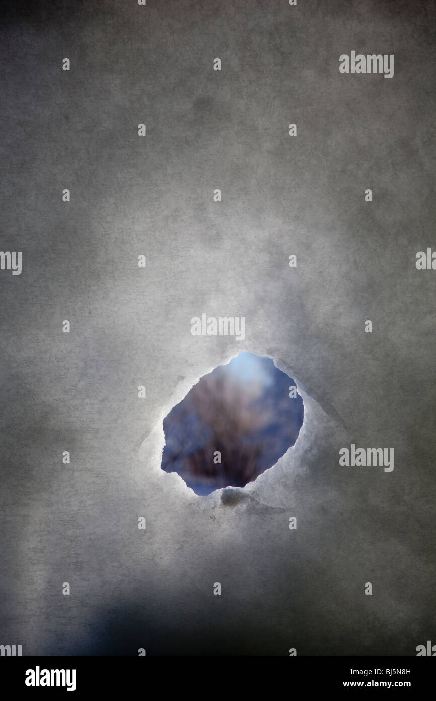 Hole on snow wall Stock Foto