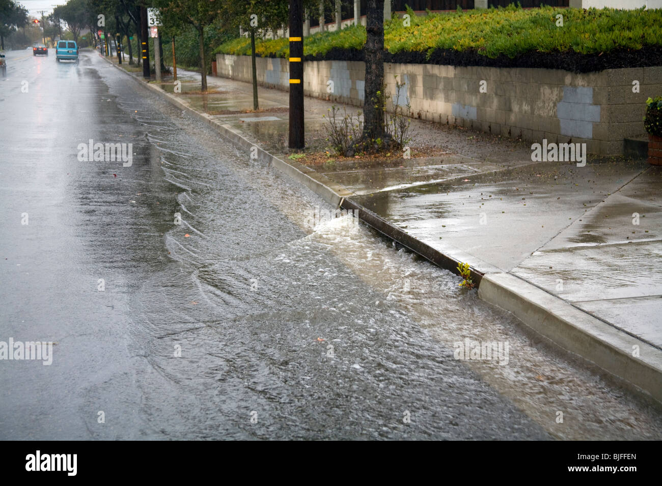 Heavy Rains Flow Down Streets Into Street Gutters And