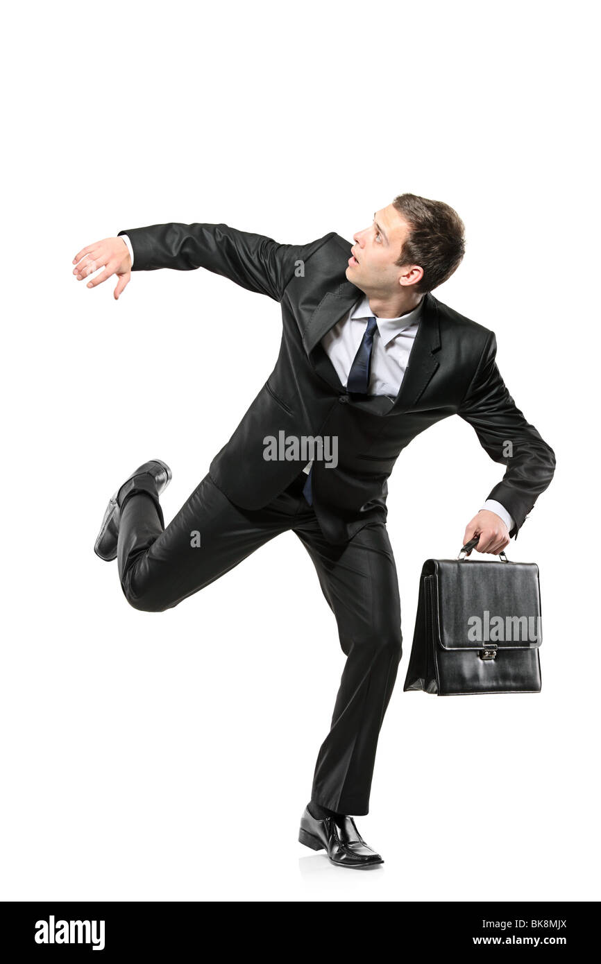 An afraid businessman running away Stock Photo