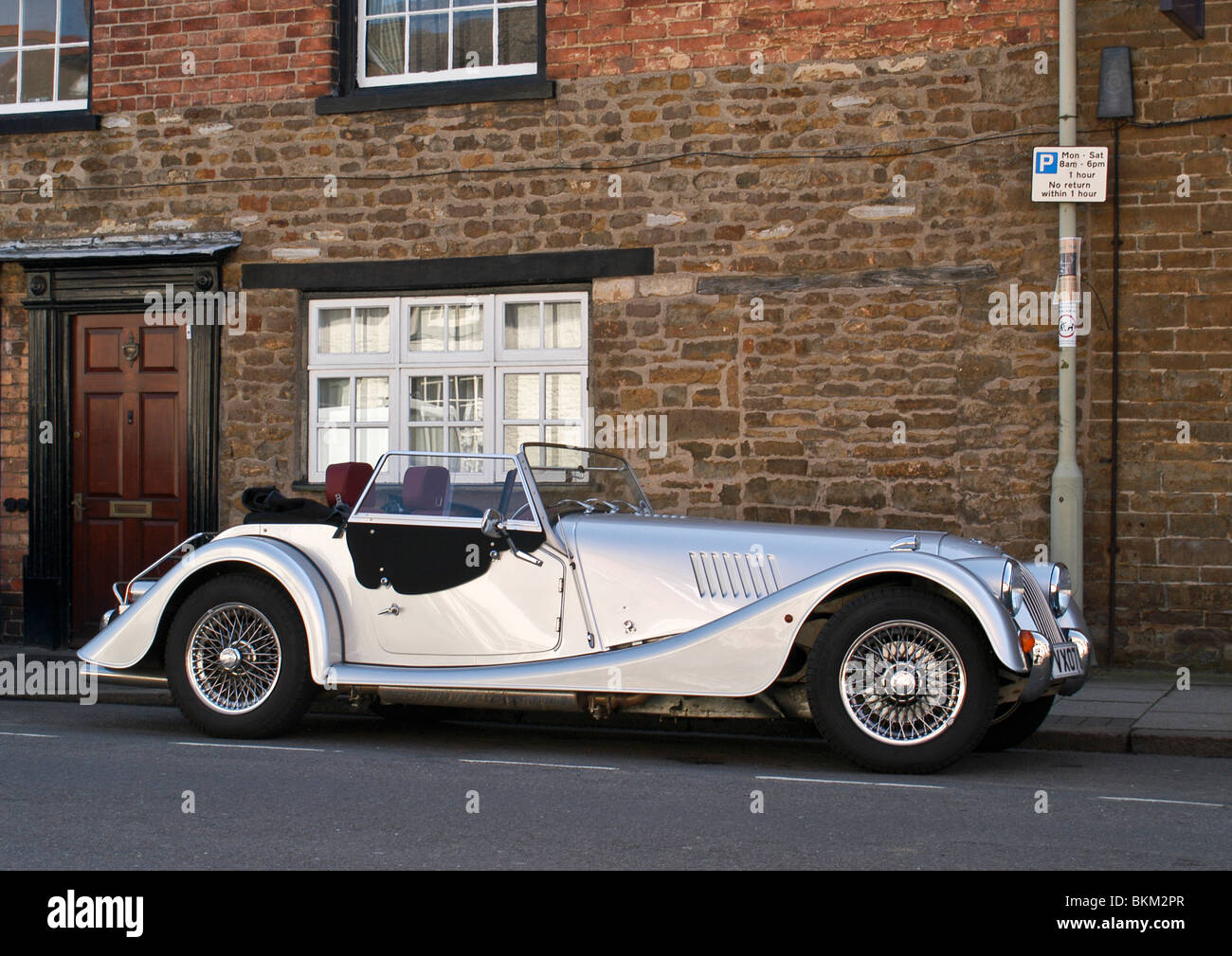 side view of martin vintage convertible sports car in shining silver stock photo royalty free. Black Bedroom Furniture Sets. Home Design Ideas
