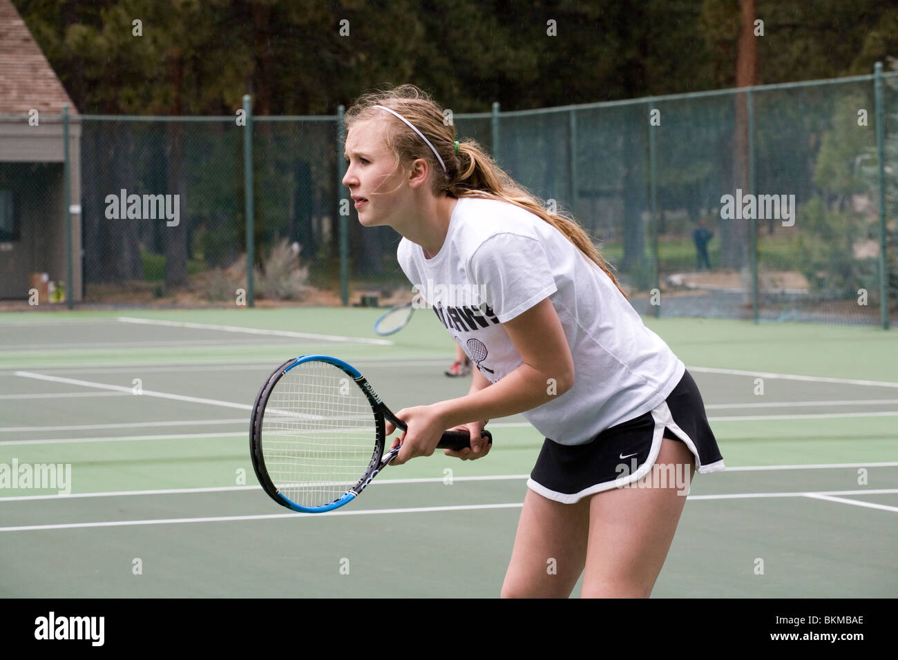 A high school tennis player on the varsity team at a ...