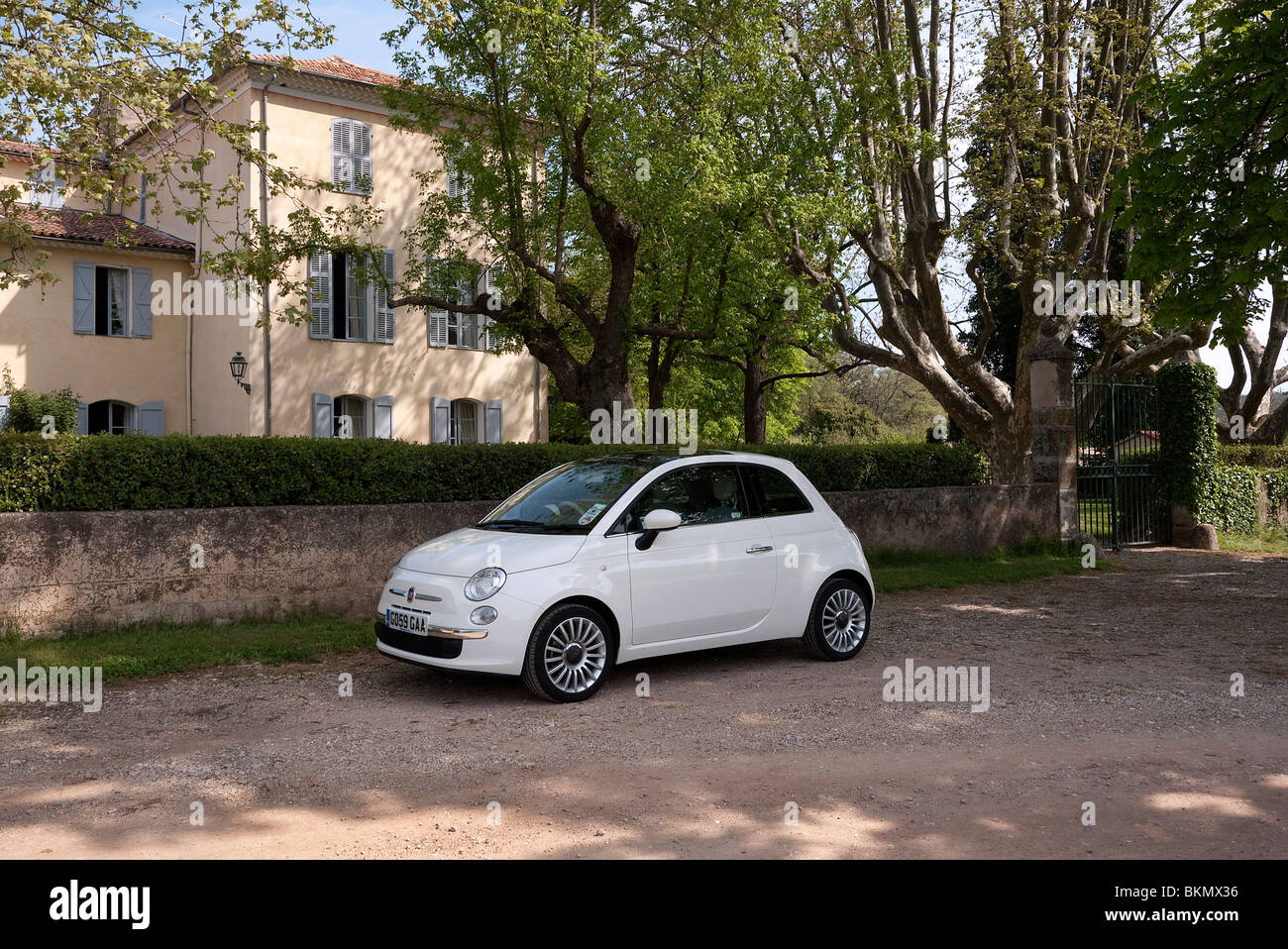 fiat 500 parked by a chateau la lieue provence in france stock photo royalty free image. Black Bedroom Furniture Sets. Home Design Ideas