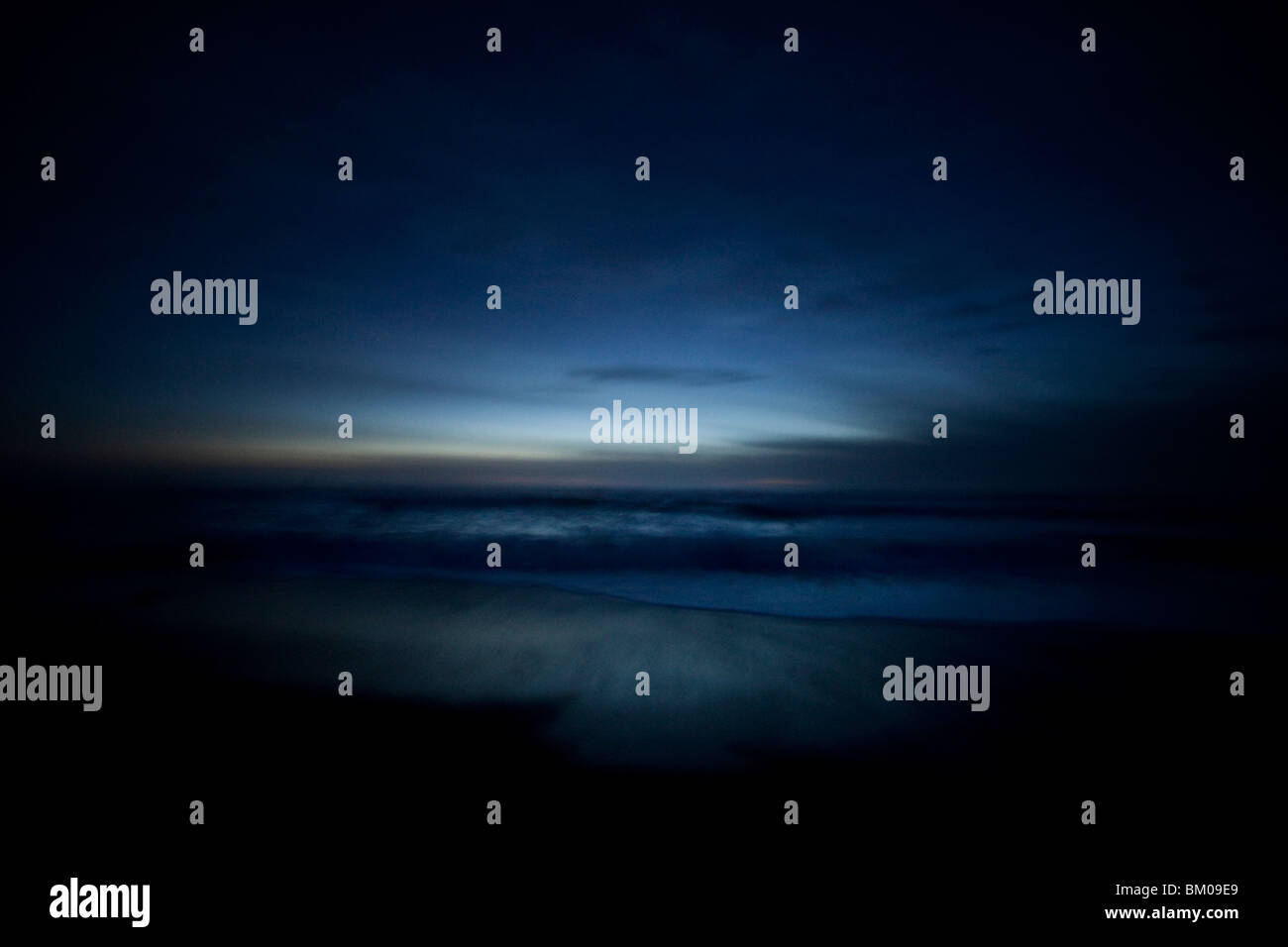 Ocean at night in Cambria, California USA Stock Photo