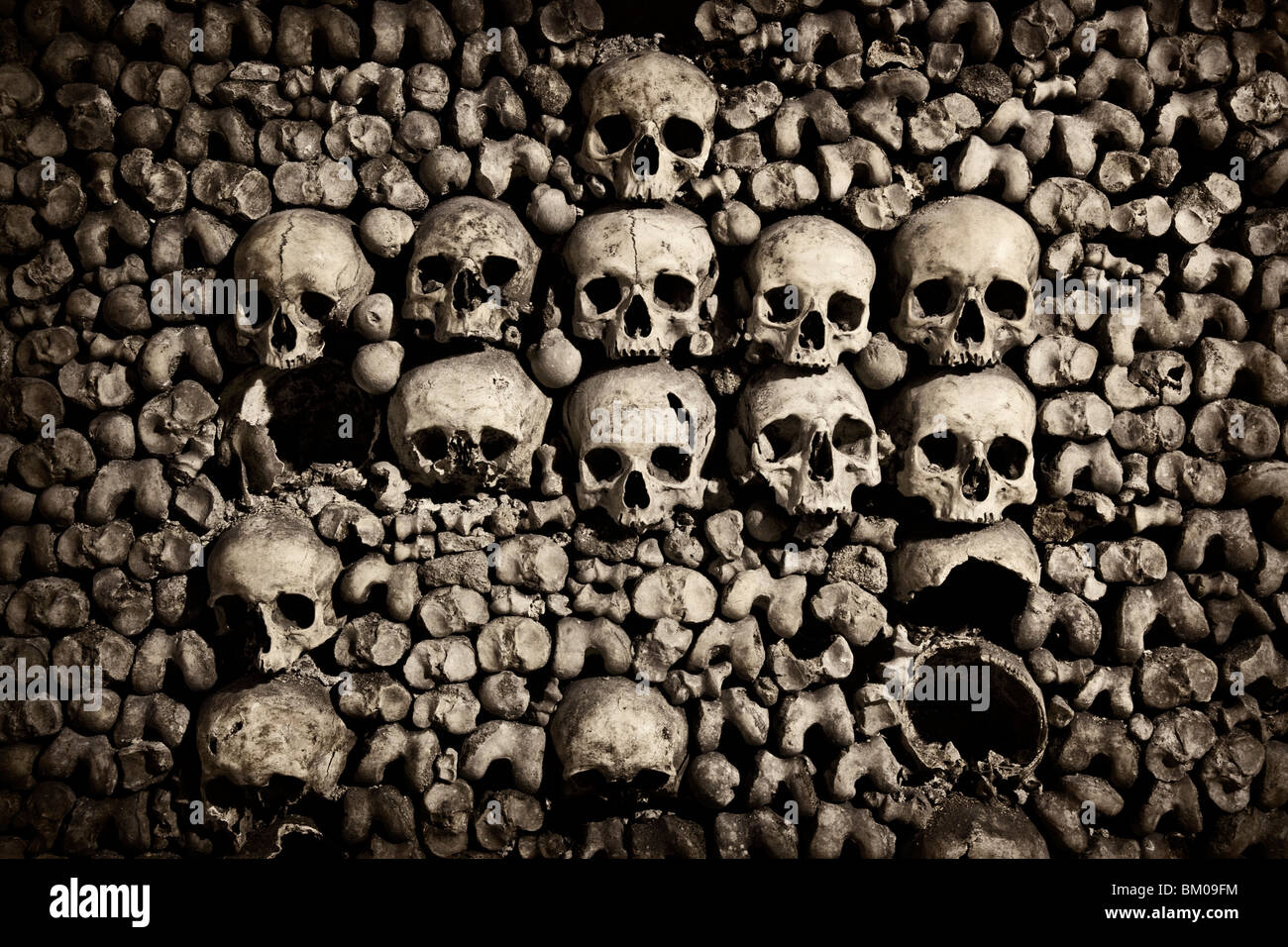 Close up of skulls in the Catacombs below Paris Stock Photo