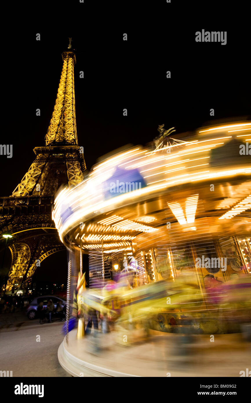 Ferris wheel and the Eiffel Tower at night Stock Photo