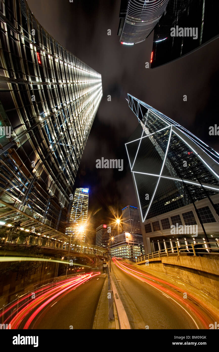 Car trails and skyscrapers at night in Hong Kong Stock Photo
