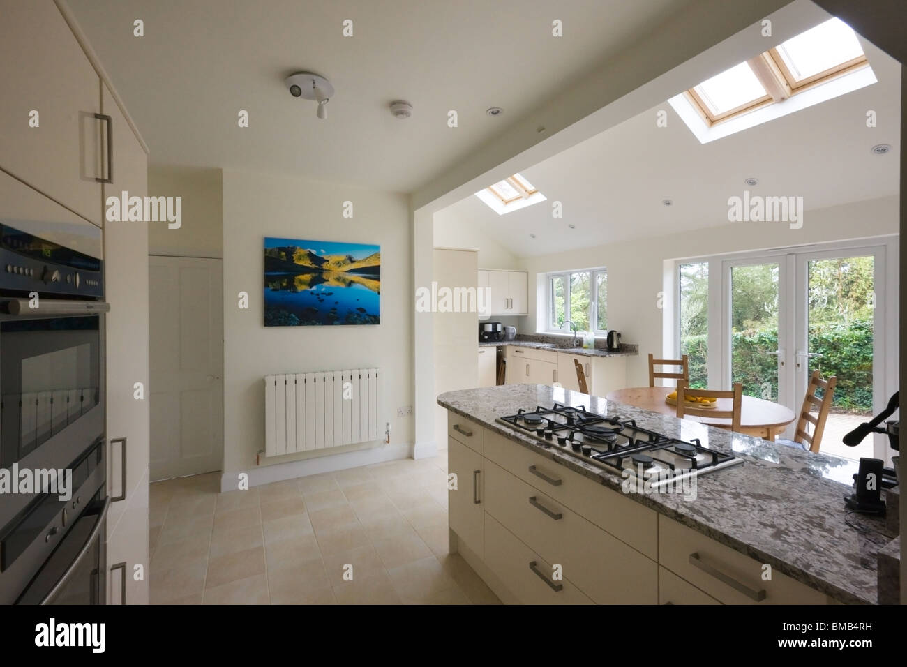 Wide angle view of a new modern kitchen extension with for Design my own home extension