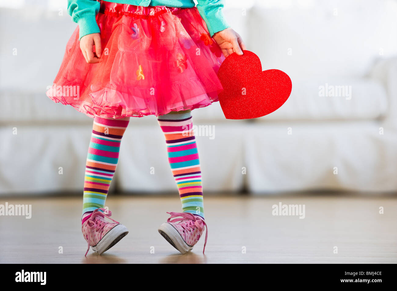 Young girl wearing colorful tights Stock Foto