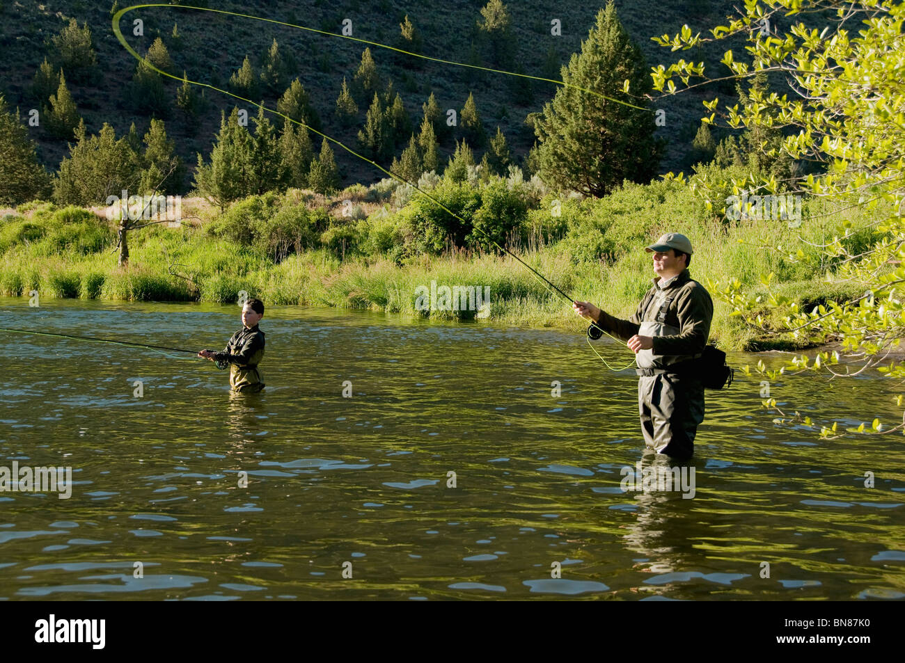 Father son fly fishing deschutes river oregon stock for Fly fishing photos