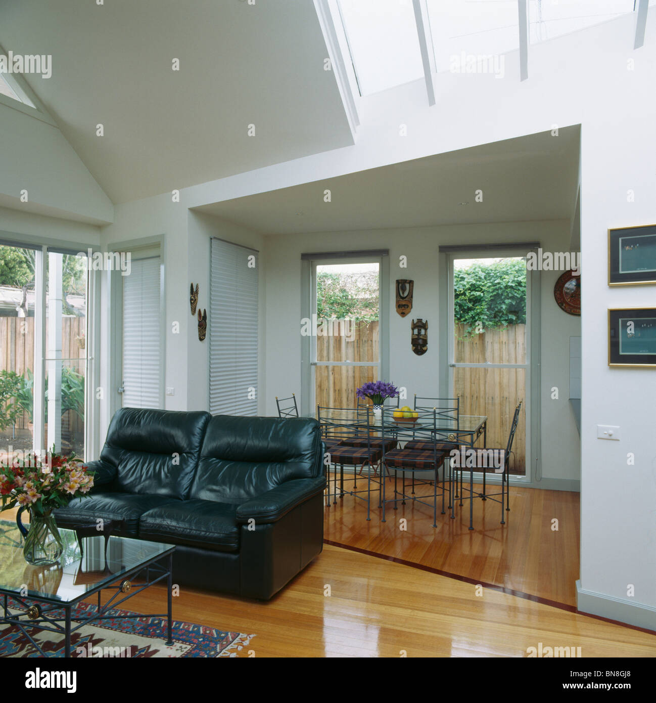 Black leather sofa in modern white open plan living and for Living room extensions