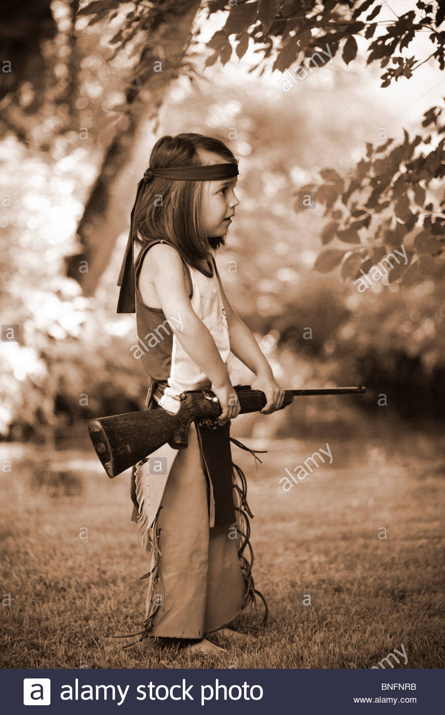 Little boy playing alone with a real rifle Stock Photo