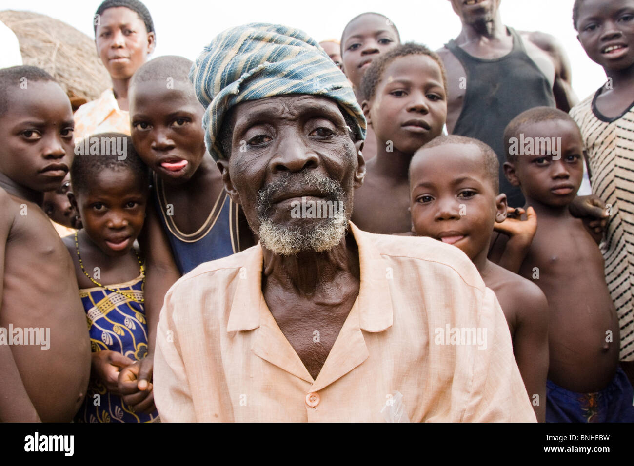 The chief of Bouchipe, a village in the Gonja Triangle, Damango district, with some of the children of the village. Stock Photo