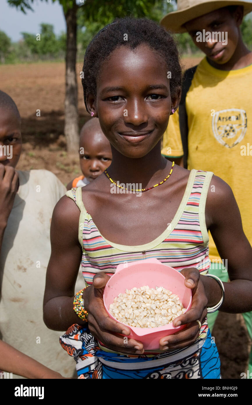 A young girl helping with the sowing of the maize crop in a Fulani compound in a village in Damango district, Ghana. Stock Photo
