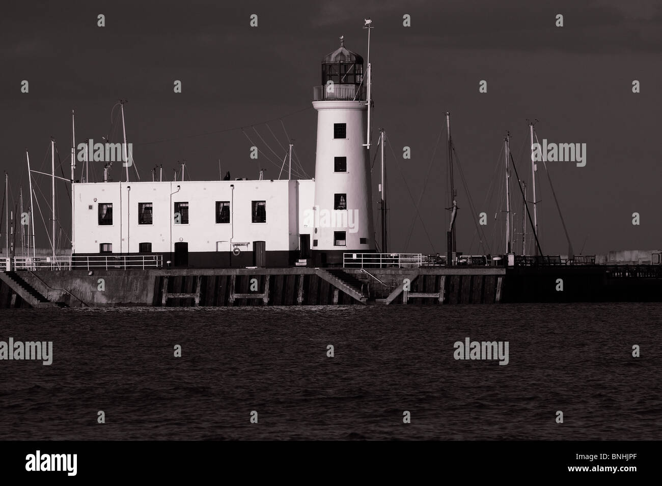 The lighthouse in Scarborough at night; in black and white ...