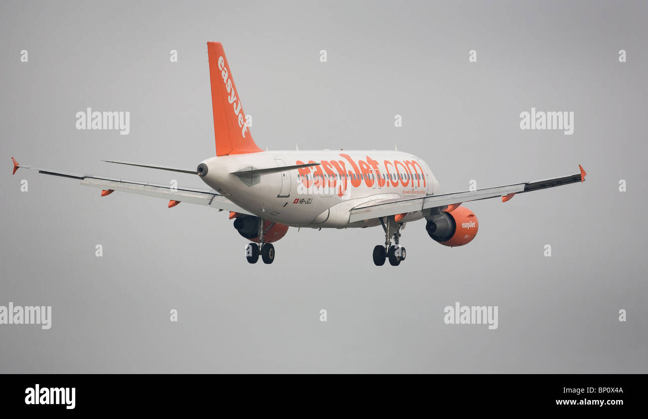 A EasyJet aircraft comes into land at London's Gatwick Airport. Picture by James Boardman Stock Photo