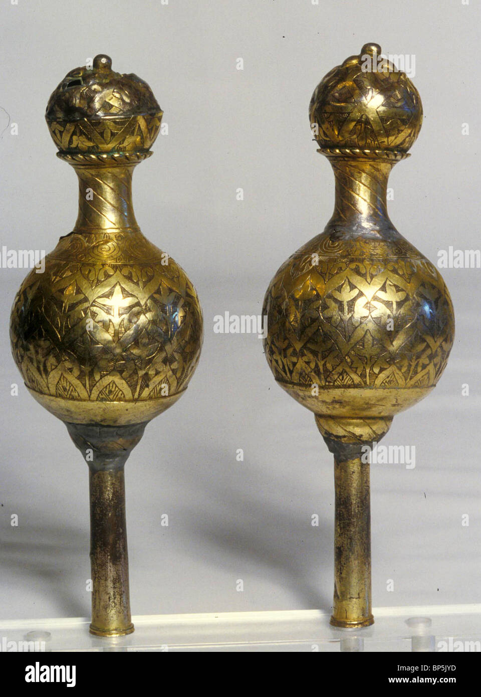 SAMARITAN ANCIENT GOLD COATED TORAH FINIALS - RIMONIM. THE RIMONIM ARE PUT ON THE CASE CONTAINING THE TORAH FOR Stock Photo